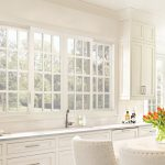 Large vinyl gliding windows in kitchen