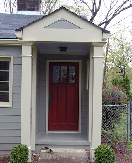 Replacement entry door in Milwaukee on blue house