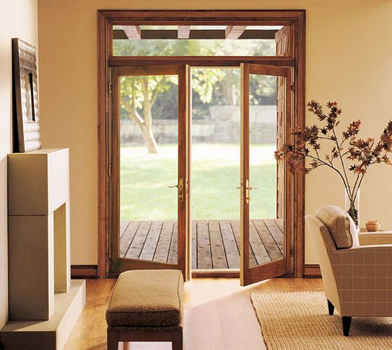 hinged patio replacement doors overlooking wood deck